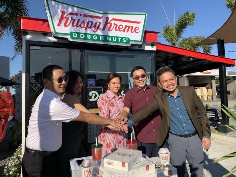 (L-R) Krispy Kreme franchisees Ariel de Dios, Gina de Dios, Enna Santos, and Paul Santos